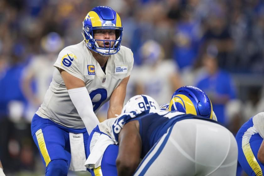 Los Angeles Rams quarterback Matthew Stafford (9) looks over the defense before the snap during an NFL football game against the Indianapolis Colts, Sunday, Sept. 19, 2021, in Indianapolis. (AP Photo/Zach Bolinger)