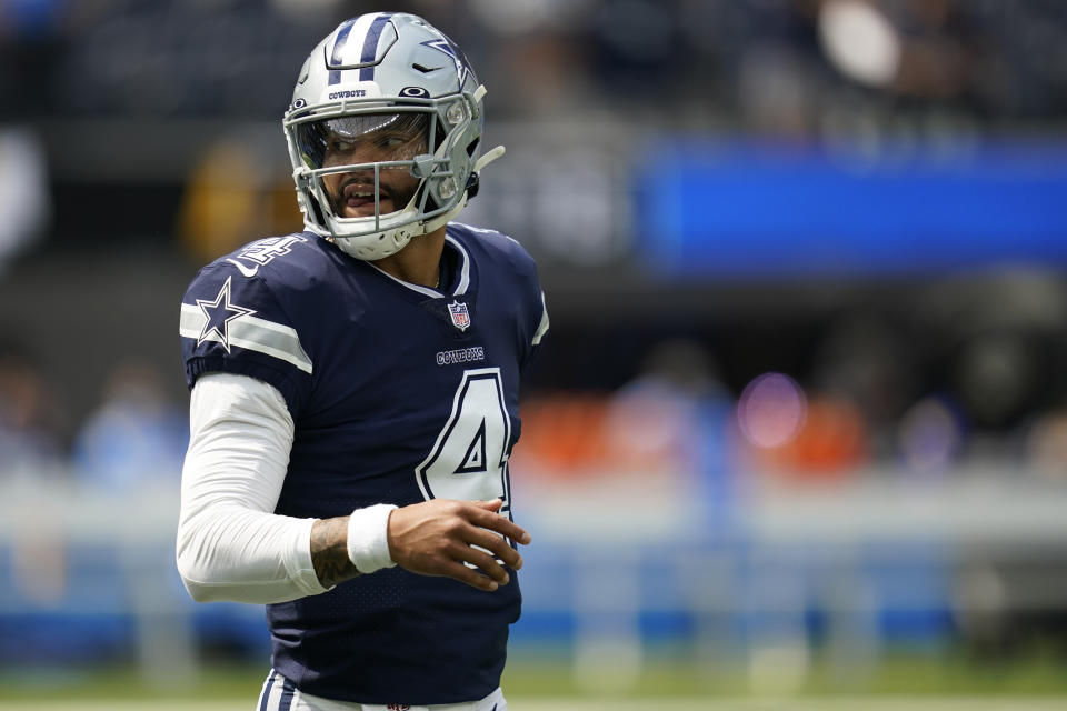 Dallas Cowboys quarterback Dak Prescott (4) warms up before an NFL football game against the Los Angeles Chargers Sunday, Sept. 19, 2021, in Inglewood, Calif. (AP Photo/Ashley Landis )