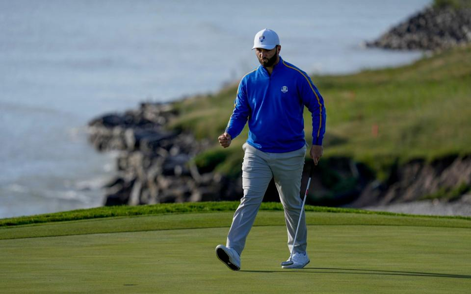 Team Europe's Jon Rahm reacts after making a putt to win the eighth hole - AP