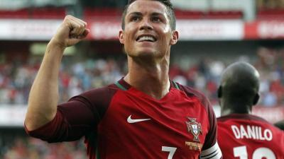 Portugal's Cristiano Ronaldo celebrates after scoring against Estonia during their friendly soccer match at Benfica stadium in Lisbon, Wednesday, June 8 2016. Portugal will play in the Euro2016 in Group stage against Austria, Hungary and Iceland in Group F. (ANSA/AP Photo/Steven Governo) [CopyrightNotice: Copyright 2016 The Associated Press. All rights reserved. This material may not be published, broadcast, rewritten or redistribu]