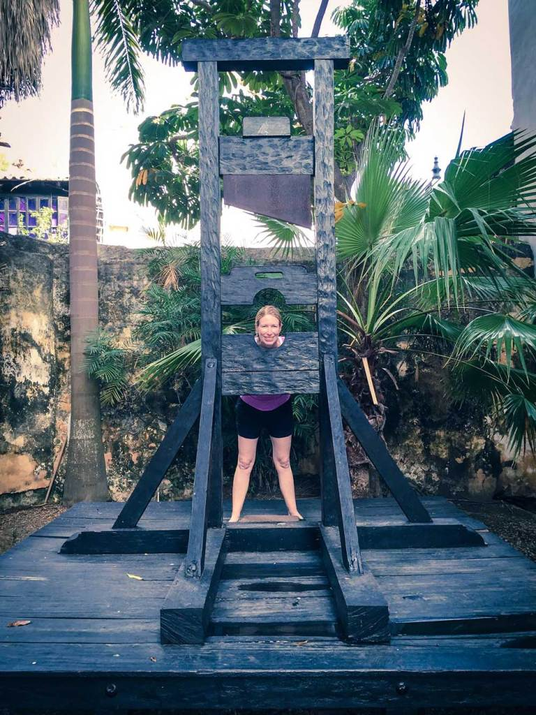 Kelly under a guillotine, Cartagena, Colombia, Fantasy Aisle Travel