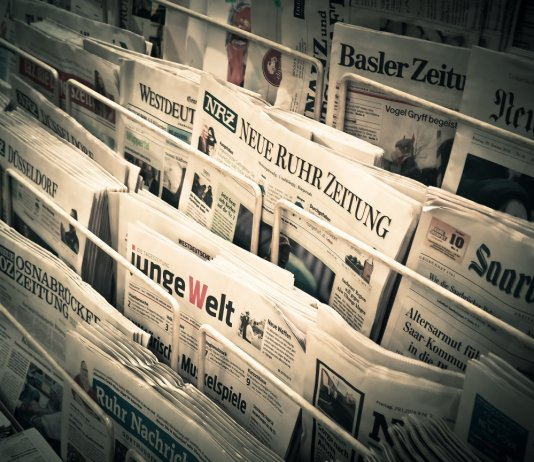 newspapers on display in a news stand