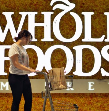 Whole Foods logo with shopper