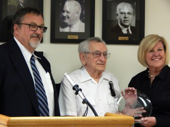 Bob receives crystal plate inscribed with Fanwood Borough Seal from Mayor Mahr, right, and Councilman/squad member Tom Kranz