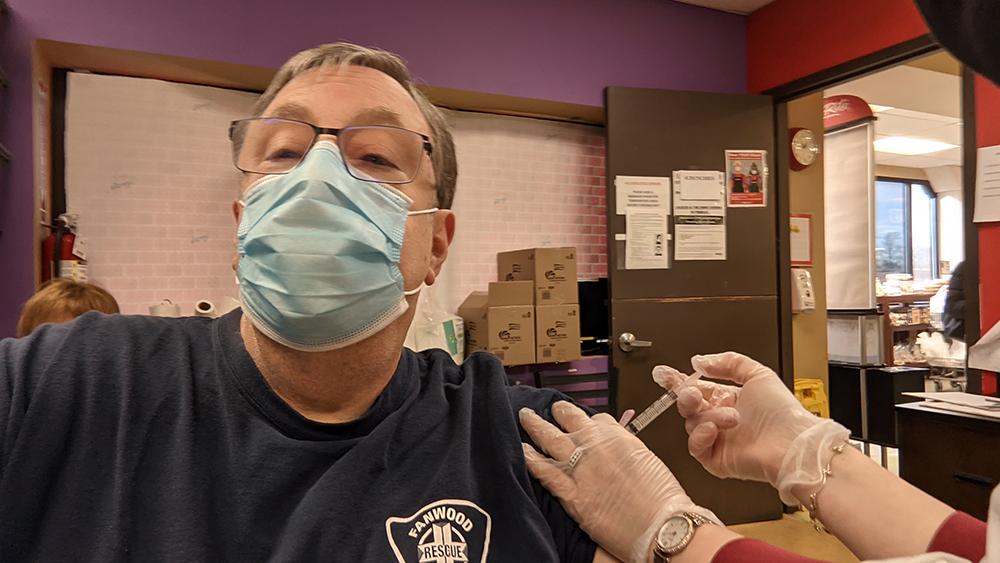 EMT gets vaccine