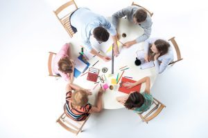 Top view of business team, sitting at a round table on white background. concept of successful teamwork