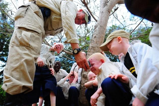 Tanzani- U.S. Army Staff sergeant Larry Vandernberg and albino chlidren