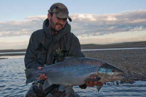 Calvin Fuller with sea run brown trout rio grande tierra del fuego