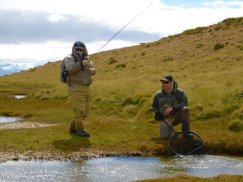 Head guide Alex Trochine and guest fishing the creek that drains from Lago Toro.