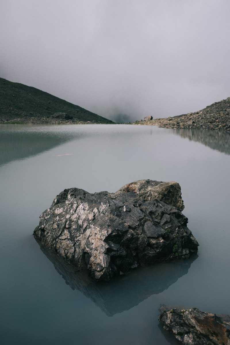 Rock in glacial lake near Roshka