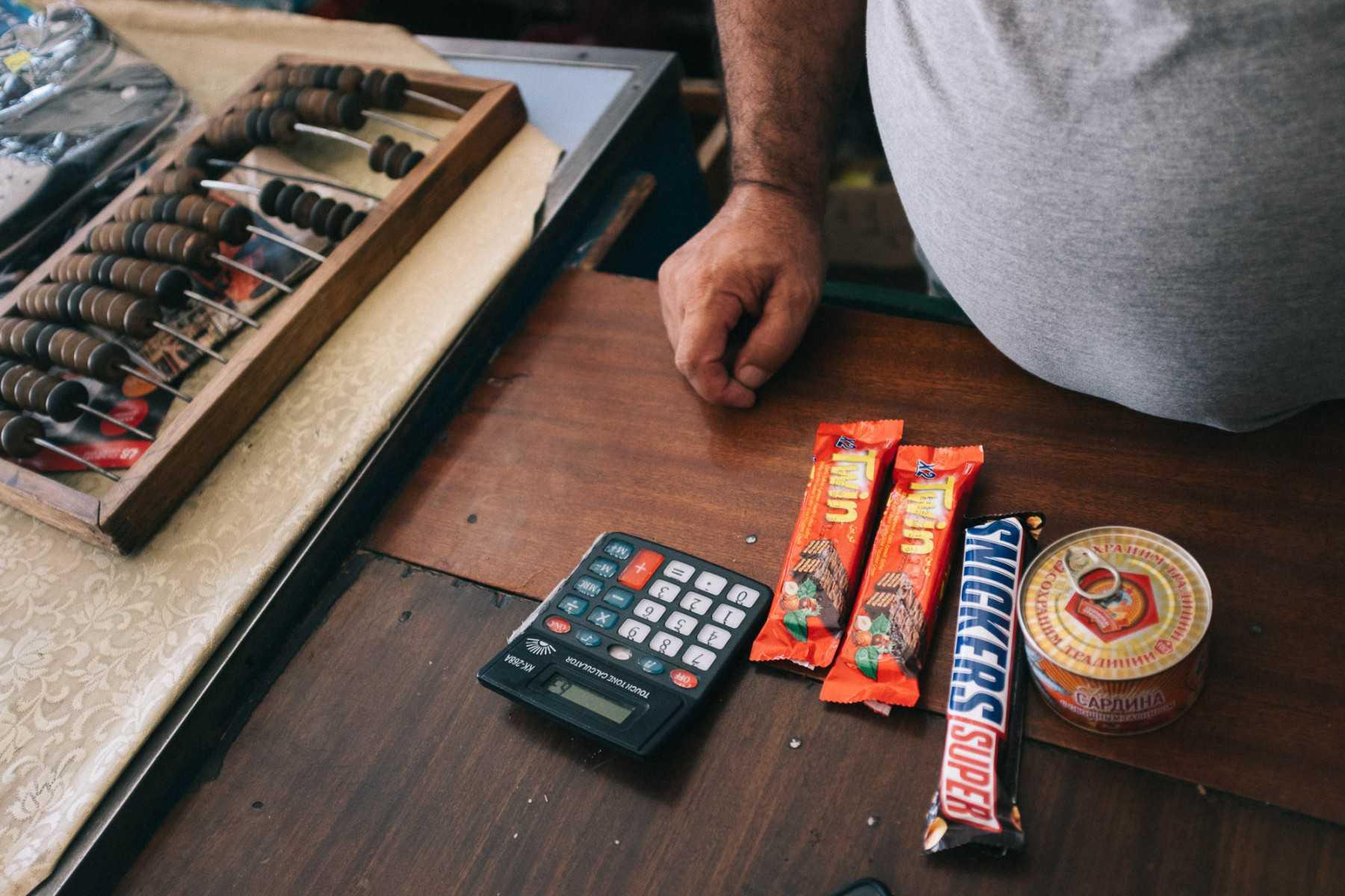 Old versus modern calculator in shop near Lagodechi