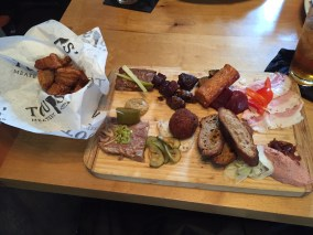 Meatery Board $25 and Pork Cracklins $8