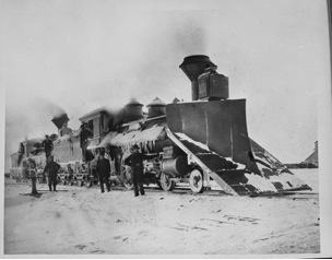 A train with a large scoop used to push snow off of the track during its winter operation. Photo circa, the early 1880s. (North Dakota Institute of Regional Studies)