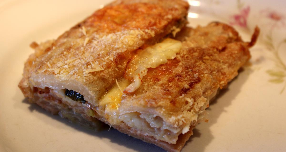 Parmigiana di coste con pastella di farro