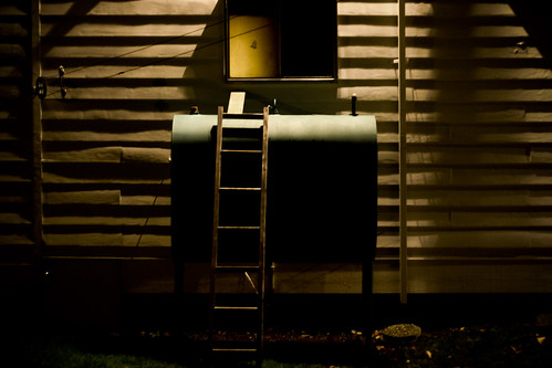 Oil tank at night by Nate Beaty.