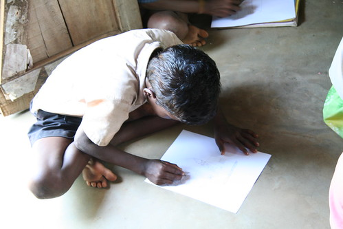 boy drawing picture for Art2Heart