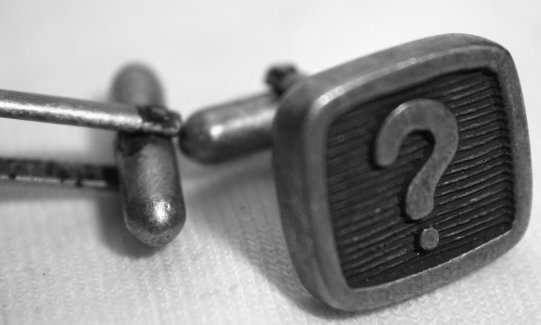 Cufflinks with question mark on them.