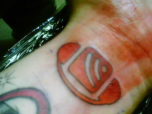 Photo of an RSS icon tattooed on a person's wrist