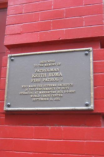 A commemorative plaque on Patrolman Roma's firehouse.