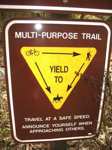 Bike path sign: Bikes yield to pedestrians