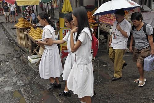 schoolgirls in uniform commuting to school street sidewalk scene  Buhay Pinoy Philippines Filipino Pilipino  people pictures photos life Philippinen