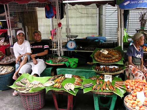 tinapa laughing Philippines seafood,vendor,sitting boys teenager dried fish market