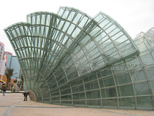 Exploring Macau - Damon posing with the giant glass structure - funny... :)