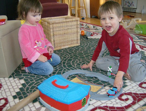 Joy and Luke playing with Jacob's train set