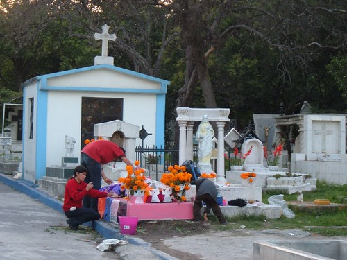 Family decorating grave