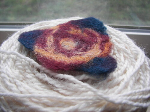 flower blob on white yarn ball
