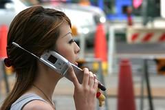 Woman at cellphone, Tokyo, Japan