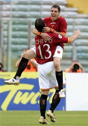 soccer players hugging