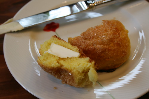Warm saffron bun with plugra butter