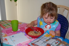 Grace reads her magazine as she eats breakfast!