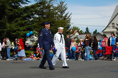 Two octogenarian war veterans walk the parade route