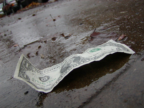 Dollar wet ground