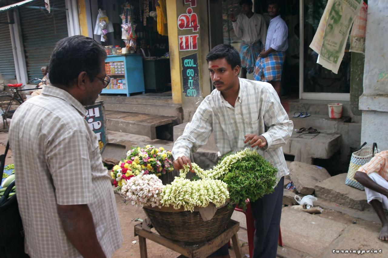 Vendor selling flowers in South India on the Street