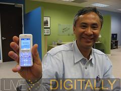 IMG_4031 patrick lo holding new netgear skype phone