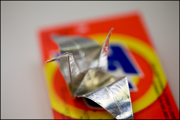 a fuzzy tribute to Andy Warhol and his Brillo boxes, the great silver crane of consumerism