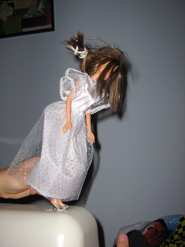 barbie in bridal gown, about to commit suicide