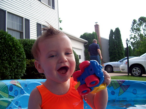 Brian very happy to be in the pool and eating a rubber ducky.
