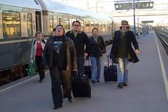 Sari, Jukka, Mekku, and Hal walking beside the train