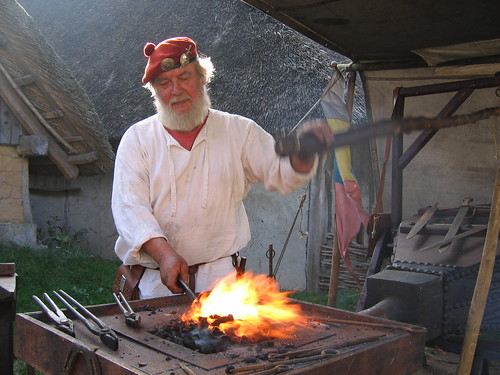 image of a man smithing steel