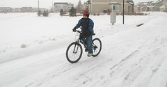 Ian rides his bike in the snow
