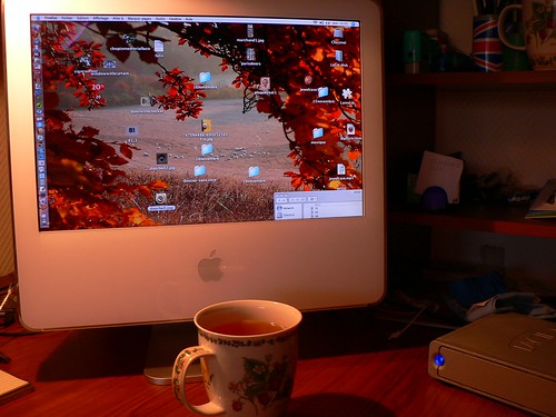 Cup of tea and cluttered desktop