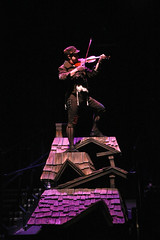 """Michael McGurk as The Fiddler in the Music Circus production of """"Fiddler on the Roof"""" at the Wells Fargo Pavilion Aug 14-19. Photo by Charr Crail."""