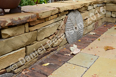 Sandtone-Seating-Wall-with-Millstone-Autumn-2015-afternoon