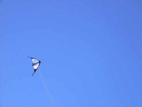 Blue kite in blue sky