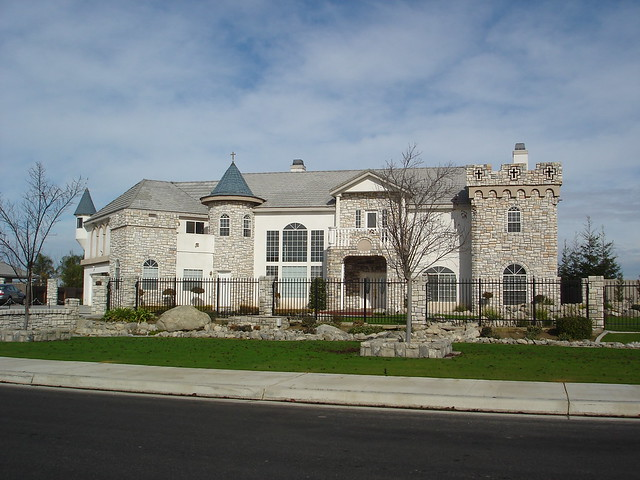 picture of faux-medieval mcmansion, with moat