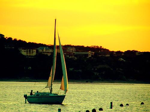 yellow sailboat sunset